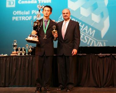 Ricker Choi receiving the Markham Music Festival trophy from Paul Rizzi of TD Canada Trust